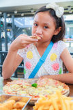 Asian girl child eat pizza Royalty Free Stock Photography
