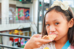 Asian girl child eat pizza Royalty Free Stock Photo