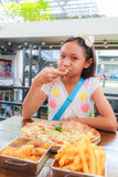 Asian girl child eat pizza Stock Photo