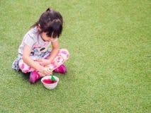 Asian girl child eating a dessert Stock Photo