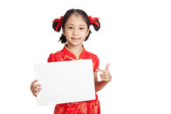 Asian girl in chinese cheongsam dress with blank sign Stock Photos