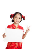 Asian girl in chinese cheongsam dress with blank sign Stock Photo