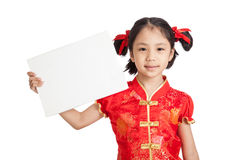 Asian girl in chinese cheongsam dress with blank sign Stock Images