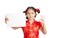 Asian girl in chinese cheongsam dress with blank sign Stock Image