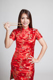 Asian girl in chinese cheongsam dress with  chopsticks Stock Images