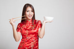 Asian girl in chinese cheongsam dress with  chopsticks Stock Image
