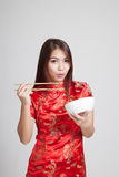 Asian girl in chinese cheongsam dress with  chopsticks Stock Photography