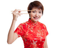 Asian girl in chinese cheongsam dress with chopsticks. stock images