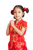 Asian girl in chinese cheongsam dress with gesture of congratula Royalty Free Stock Images