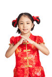 Asian girl in chinese cheongsam dress with gesture of congratula Stock Photography