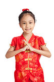 Asian girl in chinese cheongsam dress with gesture of congratula Royalty Free Stock Photo