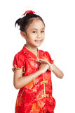 Asian girl in chinese cheongsam dress with gesture of congratula Royalty Free Stock Image