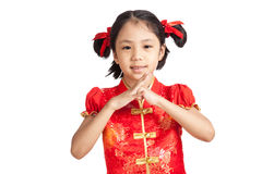Asian girl in chinese cheongsam dress with gesture of congratula Stock Photos
