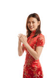Asian girl in chinese cheongsam dress with gesture of congratulation. royalty free stock images