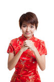 Asian girl in chinese cheongsam dress with gesture of congratulation. stock photography