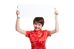 Asian girl in chinese cheongsam dress with red blank sign. royalty free stock photography