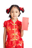 Asian girl in chinese cheongsam dress with red envelope Royalty Free Stock Photo