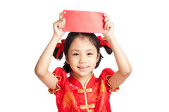 Asian girl in chinese cheongsam dress with red envelope Royalty Free Stock Image