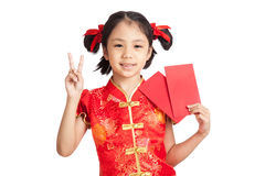 Asian girl in chinese cheongsam dress with red envelope Stock Image