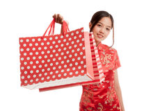 Asian girl in chinese cheongsam dress with shopping bag Royalty Free Stock Image