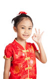 Asian girl in chinese cheongsam dress show OK sign Stock Photo
