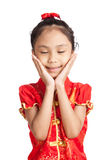 Asian girl in chinese cheongsam dress smile close her eyes Stock Images