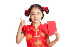 Asian girl in chinese cheongsam dress thumbs up  with red envelo Stock Images