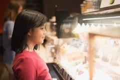 Asian girl choosing ice-cream Stock Image