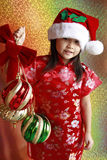 Asian girl with christmas balls Royalty Free Stock Photography
