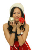 Asian girl with christmas balls Royalty Free Stock Photos