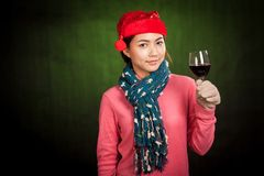 Asian girl with christmas hat and glass of wine stock photos