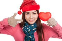 Asian girl with christmas hat point to red heart Stock Photos