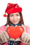 Asian girl with christmas hat show red heart focus at heart Stock Photo