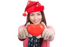Asian girl with christmas hat show red heart focus at heart Royalty Free Stock Photos
