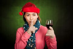 Asian girl with christmas hat  and wine do quiet sign Stock Photos