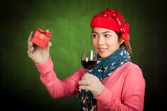 Asian girl with christmas hat ,wine and gift box Royalty Free Stock Images