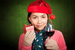 Asian girl with christmas hat ,wine and gift box Royalty Free Stock Photography
