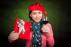 Asian girl with christmas hat ,wine and gift box Stock Images