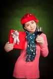 Asian girl with christmas hat ,wine and gift box Royalty Free Stock Image
