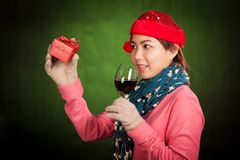 Asian girl with christmas hat ,wine and gift box Stock Photos