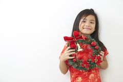 Asian girl with Christmas wreath. And Chinese New Year 2019, For the holiday background design stock image