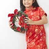 Asian girl with Christmas wreath. And Chinese New Year 2019, For the holiday background design royalty free stock images