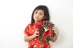 Asian girl with Christmas wreath. And Chinese New Year 2019, For the holiday background design royalty free stock photography