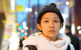 Asian girl in the city night blur background light Royalty Free Stock Images