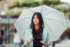 Asian girl city portrait. Royalty Free Stock Images