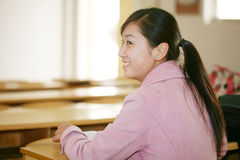Asian girl in classroom Royalty Free Stock Image