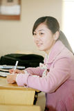 Asian girl in classroom Royalty Free Stock Photography