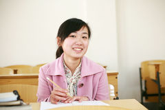 Asian girl in classroom Royalty Free Stock Images