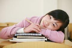 Asian girl in classroom Royalty Free Stock Photos