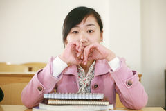 Asian girl in classroom Stock Image